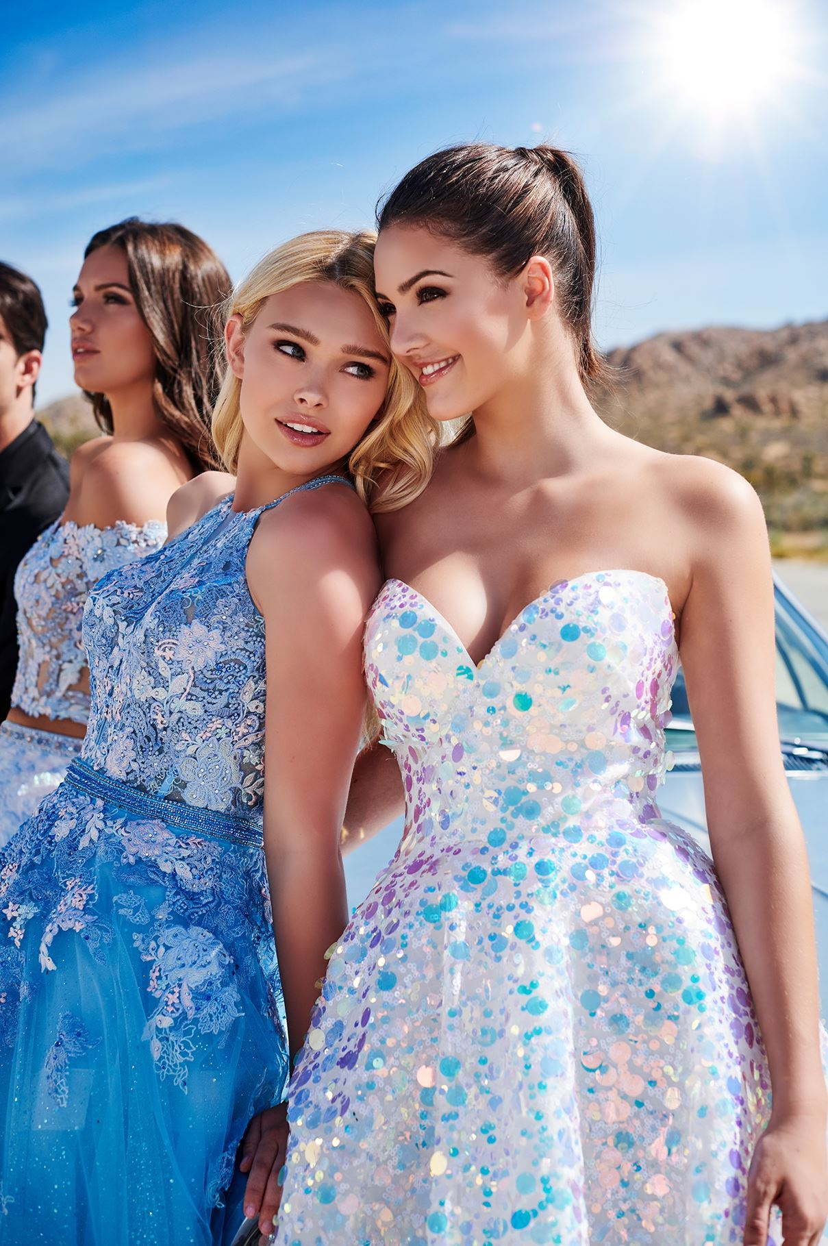 Three models in prom dresses